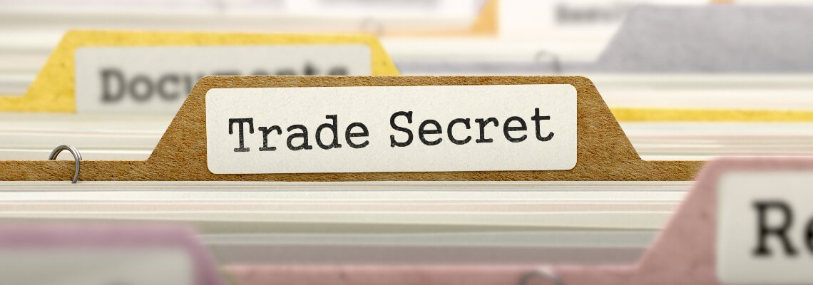 Folder with the label of Trade Secrets in a file cabinet