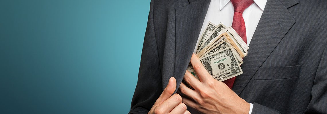 Man in suit taking cashing for his own use