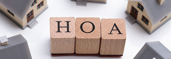 HOA letter blocks surrounded by toy houses
