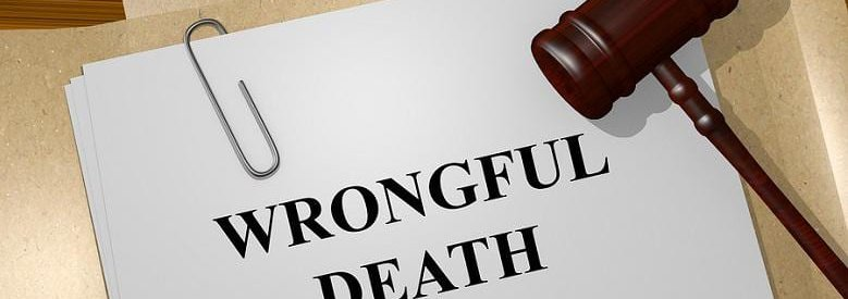 Wrongful death printed on paper with a paperclip and gavel