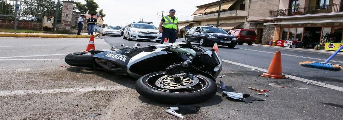 Crashed motorcycle resting in an intersection