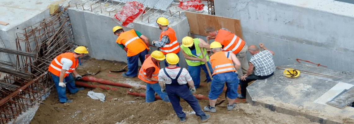 Group of construction workers digging