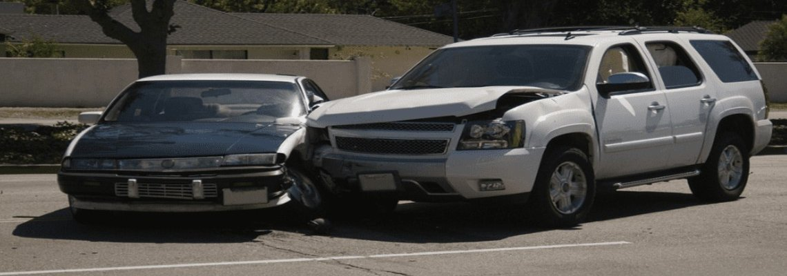An SUV and small sedan crashed in a parking lot