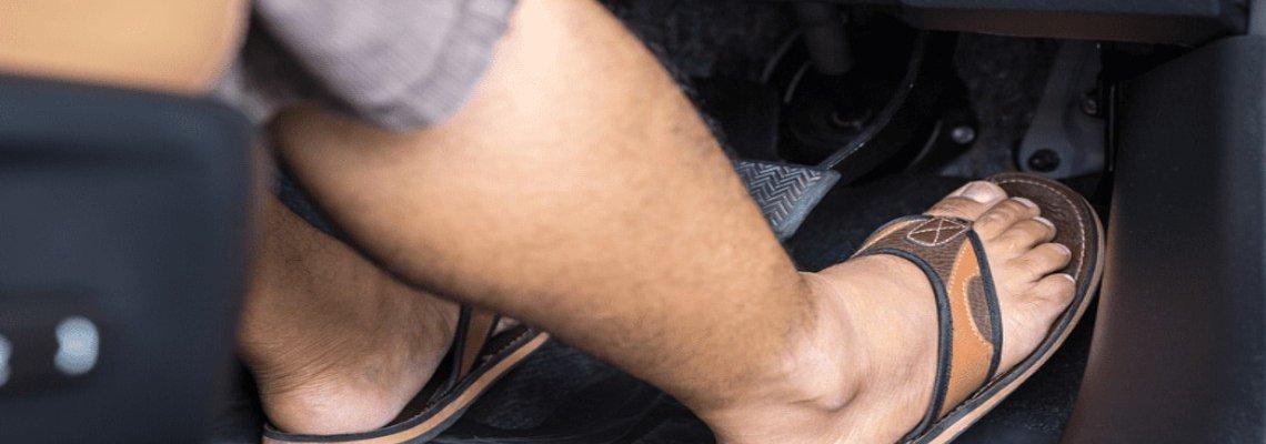 Man driving in flip-flops