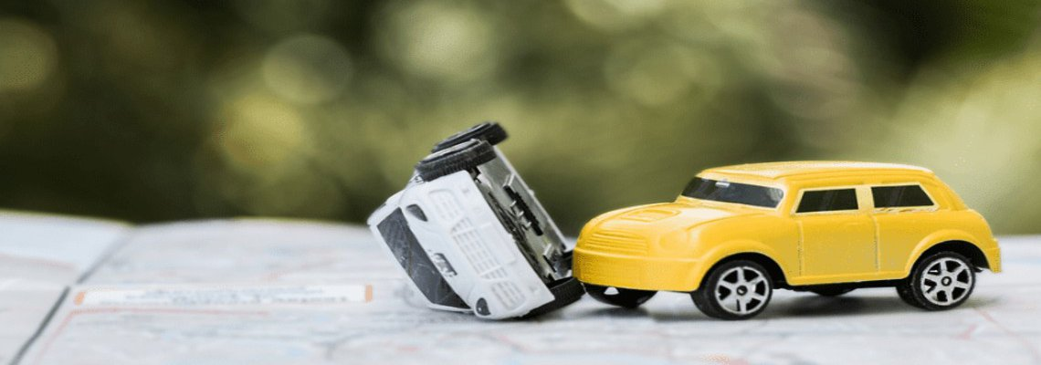 Two toy cars in an accident