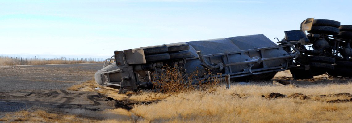 Overturned Semi-Truck on the side of the road