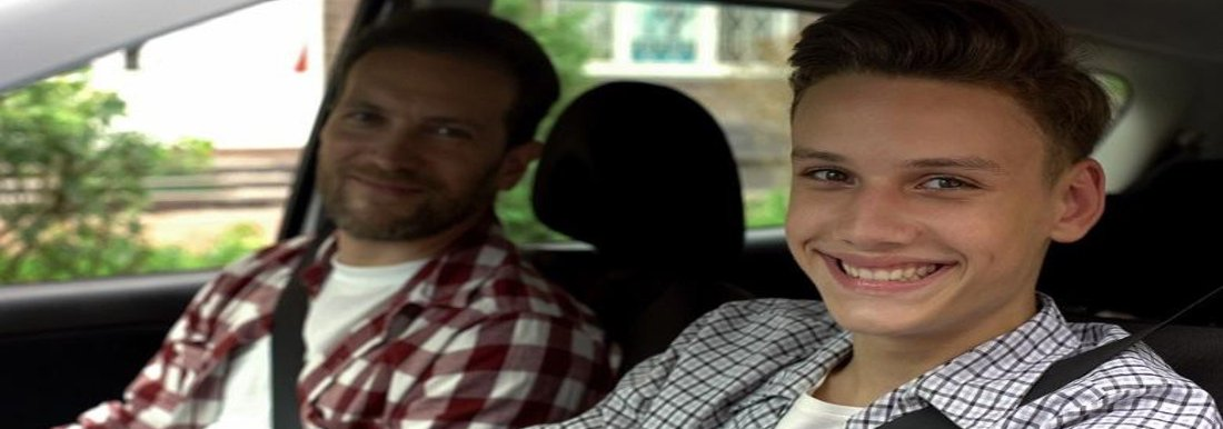 Smiling Teenager in car with Man