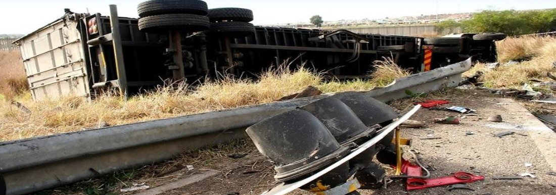 Semi truck flipped over a guardrail