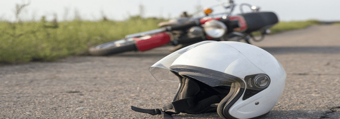 Motorcycle helmet on the ground in front of a motorcycle