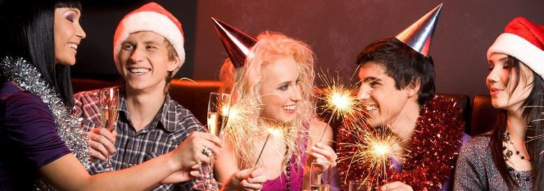 Group of people with sparklers and drinks in their hands