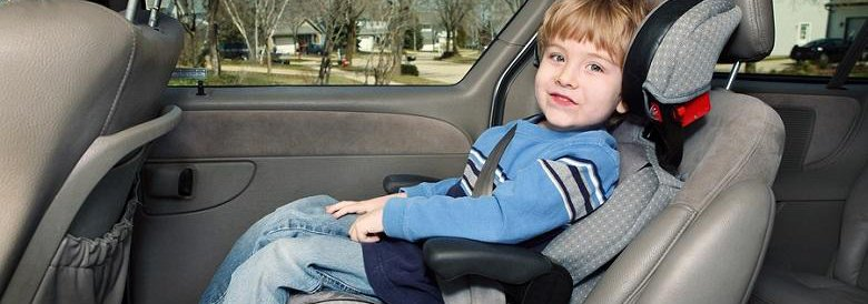 young boy in car seat in the backseat of a car
