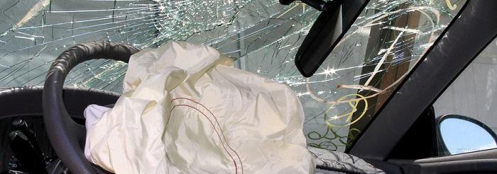 Airbag deployed in a car with windshield shattered