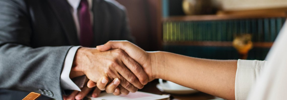 Attorney Shaking Hands with a Client
