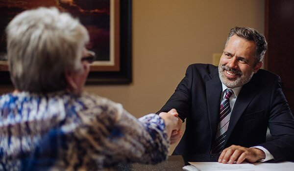 Attorney James R Nance Shakings Hands with a Client