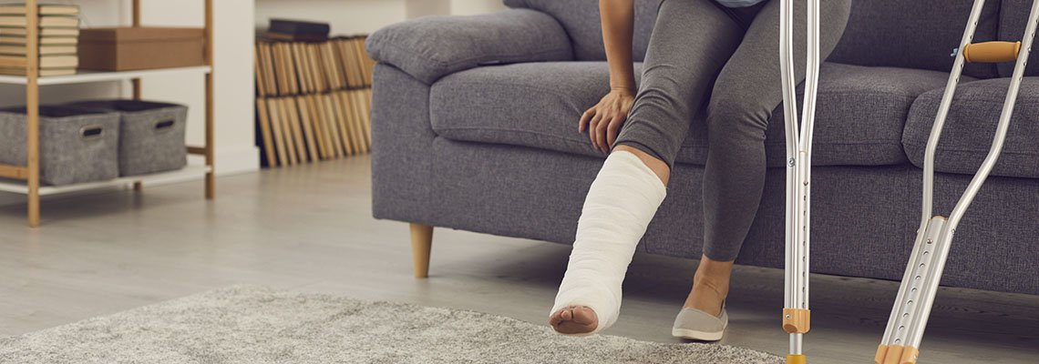 Woman struggling to get up with a cast on