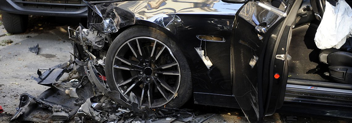 Front end of a car smashed after an accident