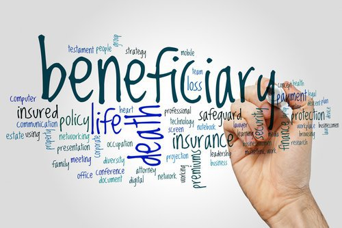 person holding a marker and writing the word beneficiary