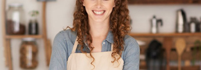 Young Lady in Cream-Colored Apron Smiling