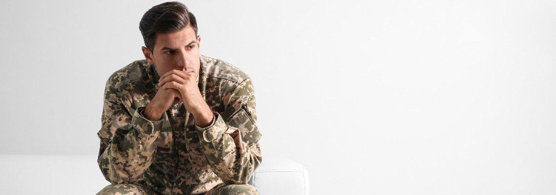 Man in military uniform looking pensive