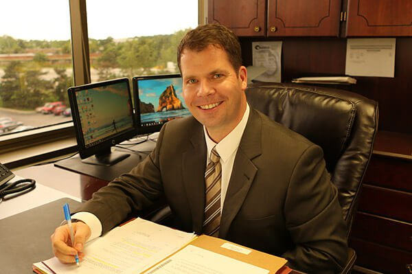 Attorney Braden A. Blumenstiel Sitting in His Office