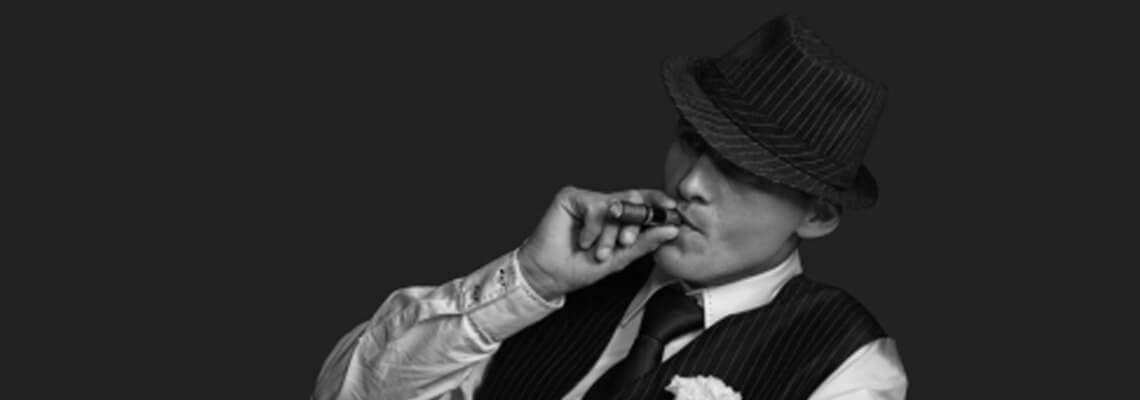 Man in Suit Smoking a Cigar