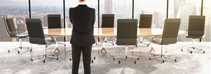 Man Standing in the Meeting Room
