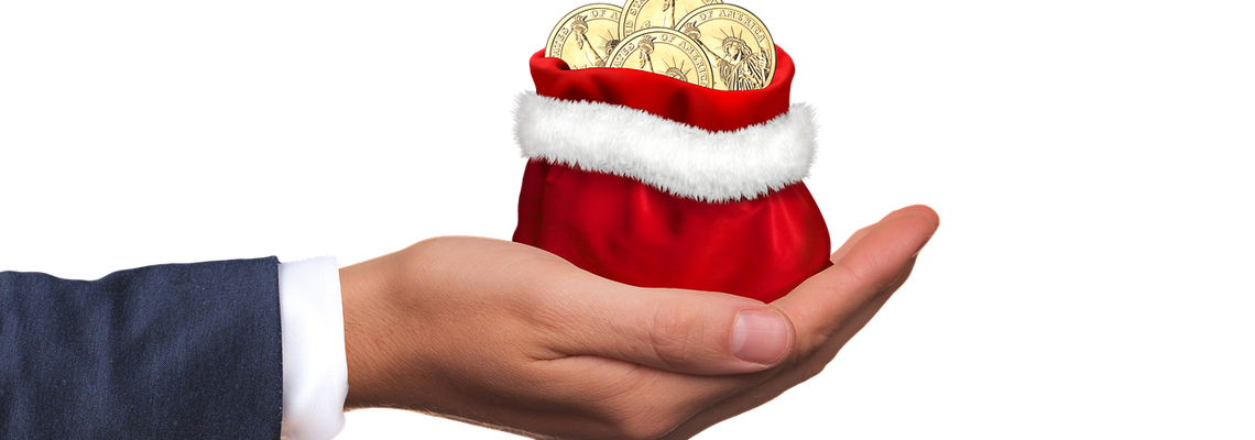 Man Holding Christmas Money