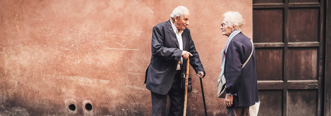 Elderly Man and Woman Talking