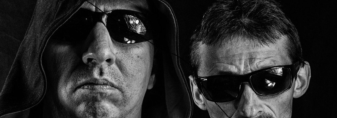 Men Wearing Sunglasses in A Dark Background