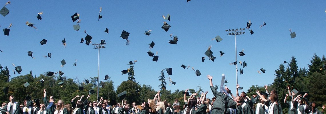 Graduates Tossing Their Cap in the Air