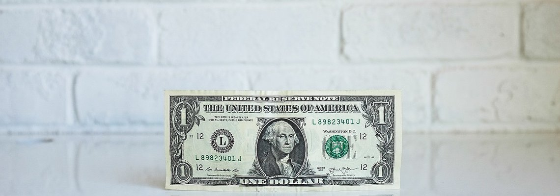 One Dollar Bill Leaning Against the Wall