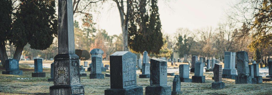 photo-of-tombstones-on-grass-field.jpg