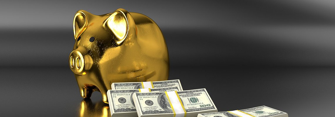 Golden Pig-Shaped Money Box and Stacks of Dollar Bills