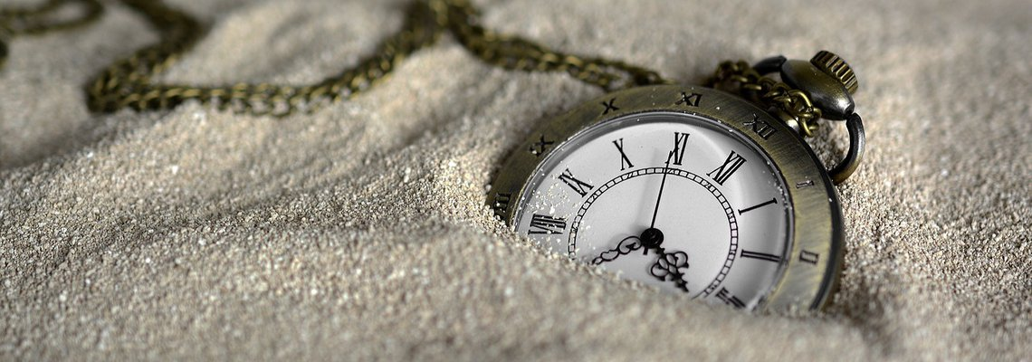 Pocket Watch on Beach Sand