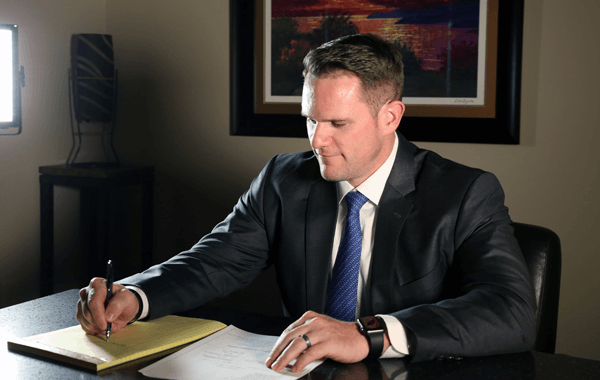 Attorney Eric Day writing
