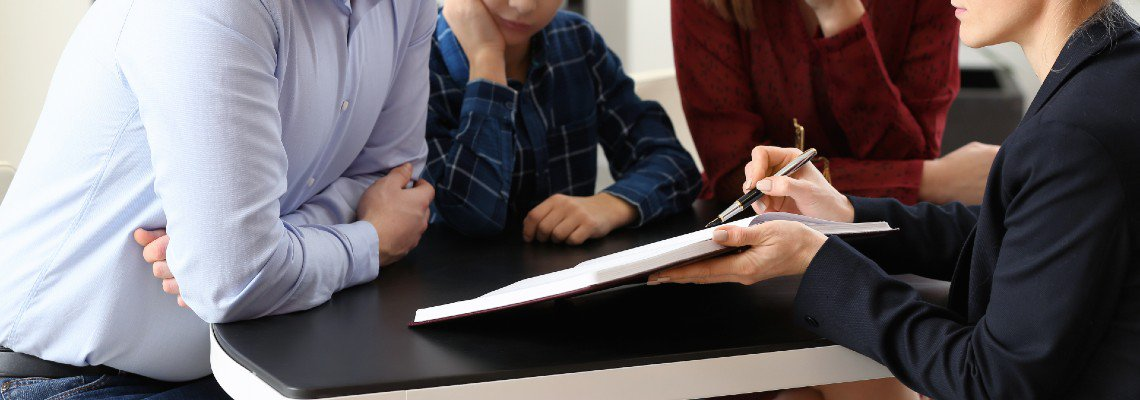 Woman going over a document with three people