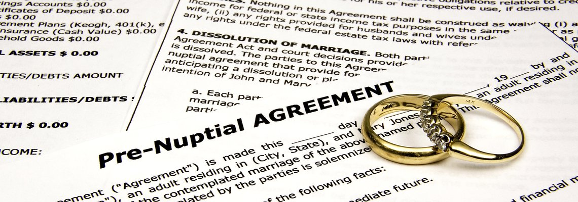 pre-nuptial agreement document with two rings on top