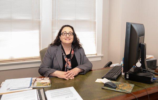 Attorney Nicole Edington siting at office desk