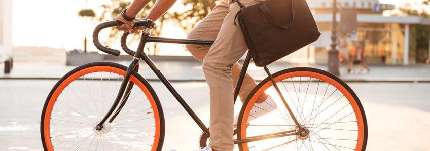 Person Riding a Bike in Dress Clothes