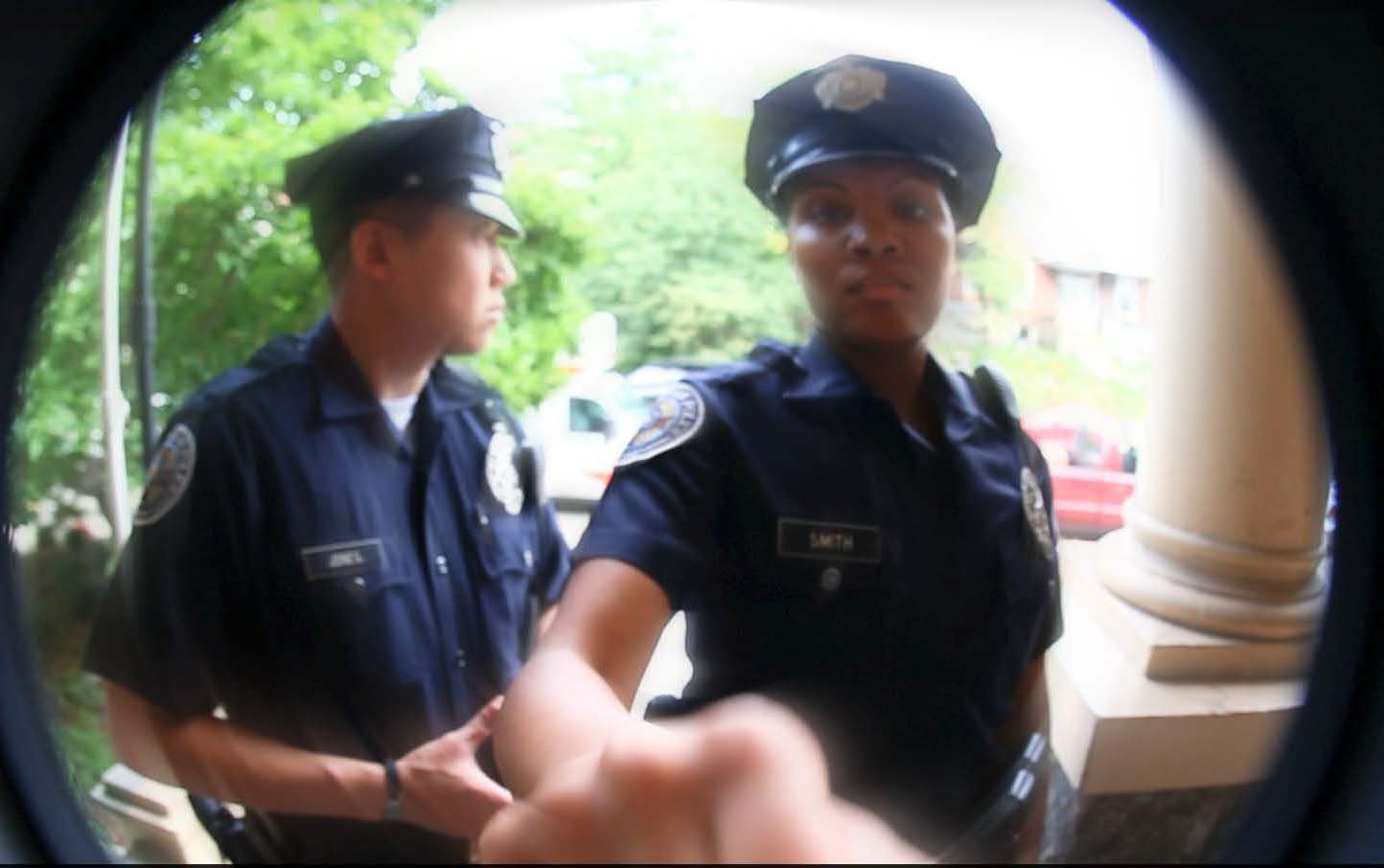 Police Officers ringing a door bell