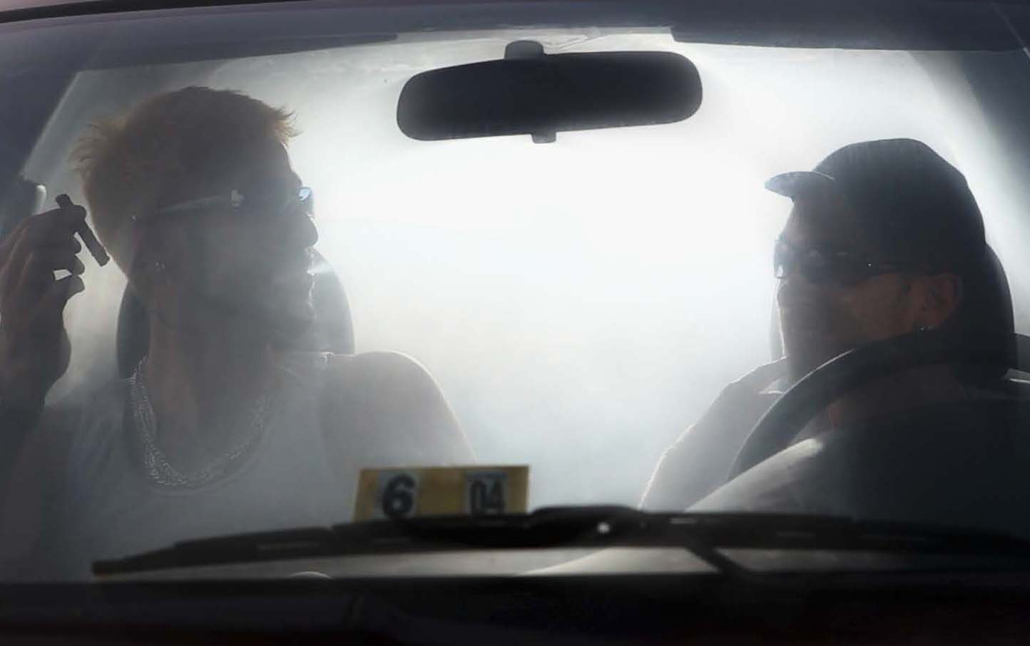 Two men in a foggy car
