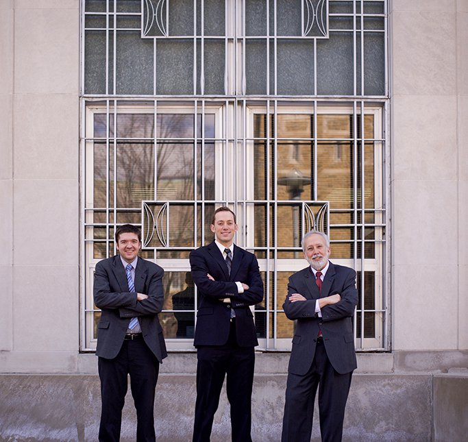 Attorneys Brandon O'Connor, Kurt Ellison, and Keith Ellison in Dark Suits