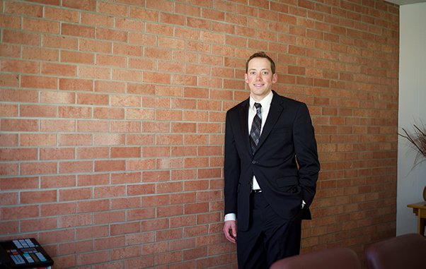 Attorney Kurt F. Ellison Smiling in Black Suit and Dark Tie