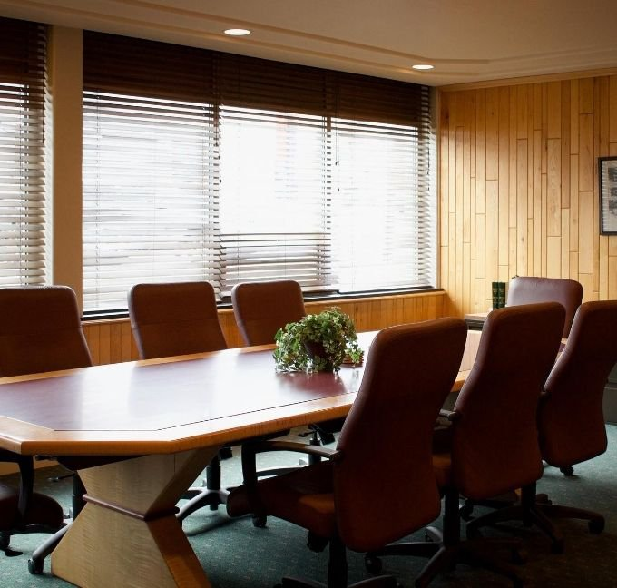 Conference table with 7 chairs around it
