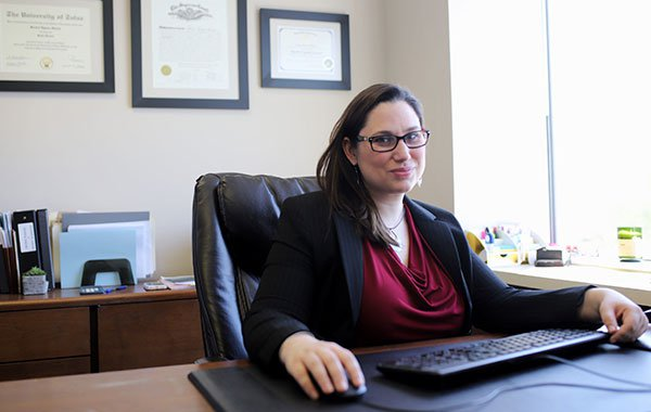 Attorney Rachel Farrar working at her desk