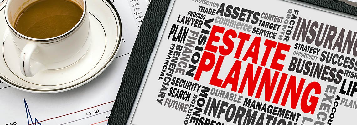 Estate planning words on a tablet next to a cup of coffee