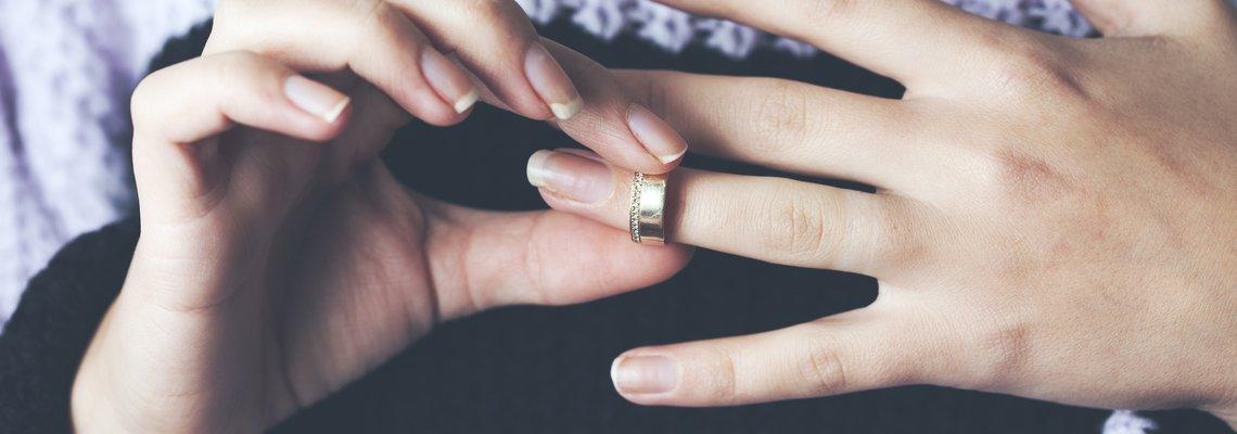 Woman removing her wedding ring.jpeg
