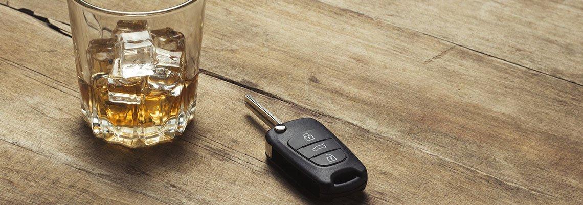 Glass of Whiskey next to keys