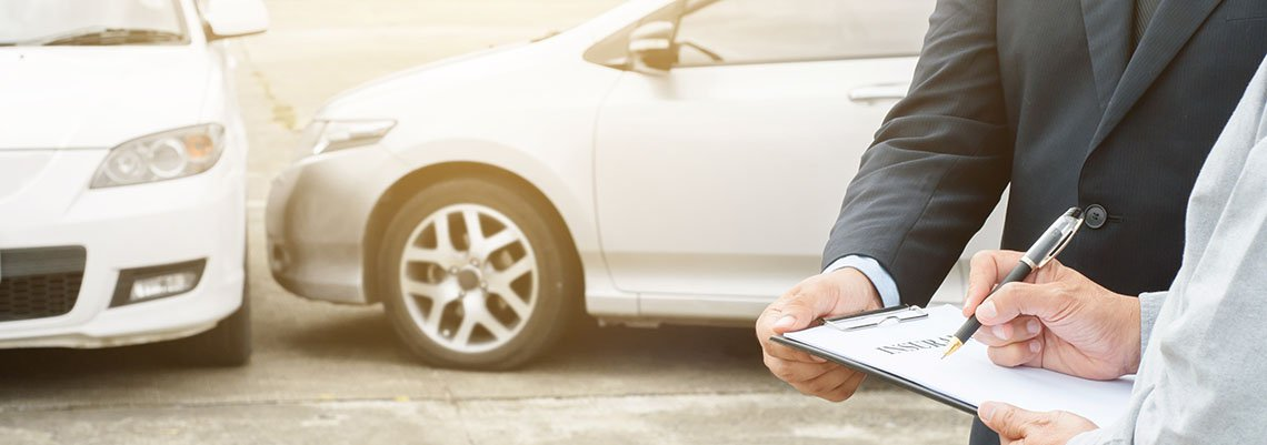 Filling out insurance information after an accident