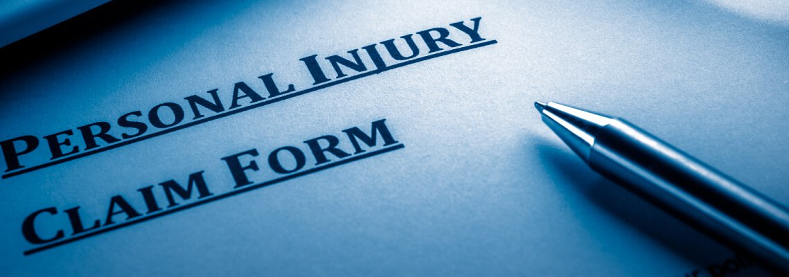 Personal Injury Claim form with pen
